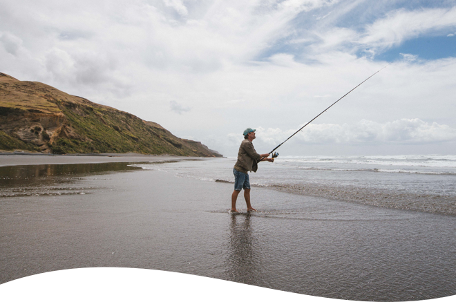Man fishing on a remote beach.