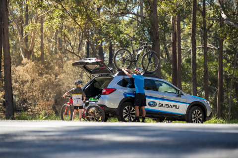 Subaru Brand Ambassador Braden Currie and his son Tarn load a Subaru Outback up with their mountain bikes after a family ride in Noosa, Australia, where Currie was training for the IRONMAN World Championship. PHOTO CREDIT: GRAEME MURRAY, FILTERED VISION.