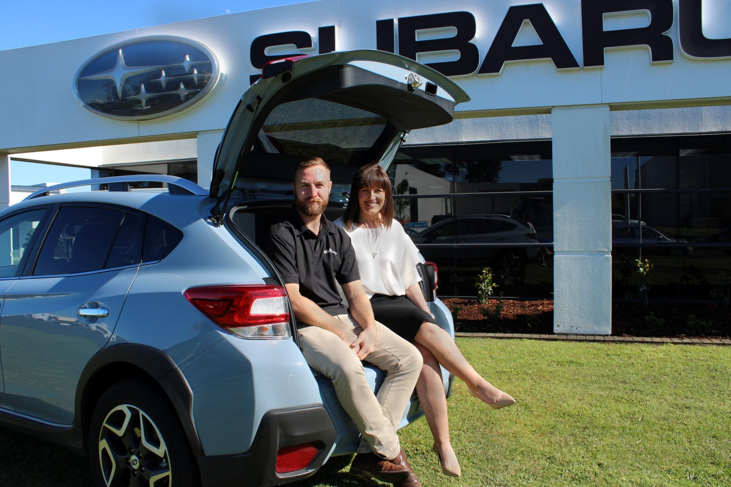 Subaru of New Zealand's Marketing Manager Daile Stephens and Stuff Event Manager Henry McIernon with the Subaru XV.