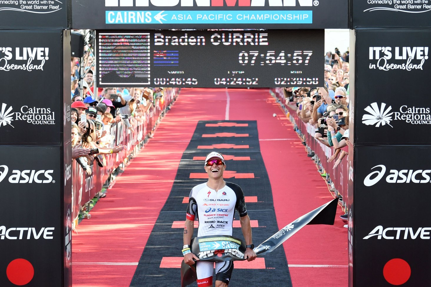 Braden Currie at the finish line as he wins Cairns Ironman 2018. Photo Credit Korupt Vision