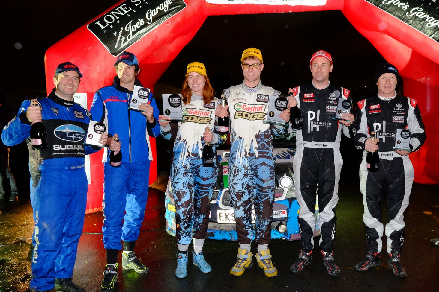 The New Zealand Rally Championship podium (from left) features Tony Rawstorn and Ben Hunt in second place, fellow Subaru team and event winners Nicole and Matt Summerfield and Josh Marston and co-driver Andrew Graves in third. PHOTO: GEOFF RIDDER