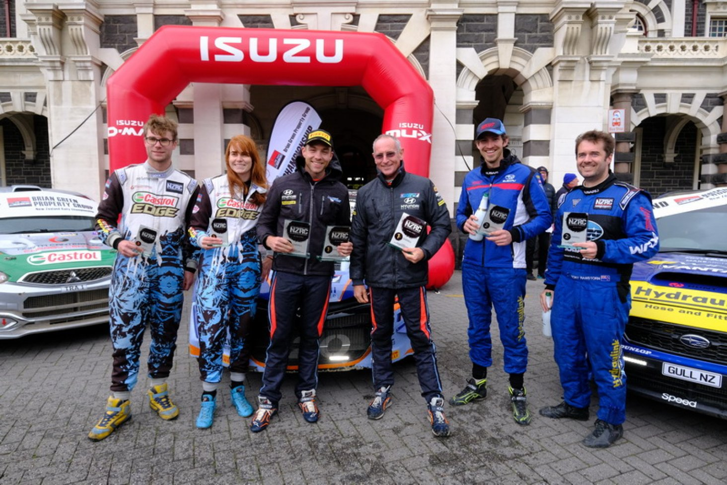 NZRC podium place-getters (from left) Matt and Nicole Summerfield in third; winners Hayden Paddon and John Kennard and runners-up Ben Hunt and Tony Rawstorn. PHOTO: GEOFF RIDDER