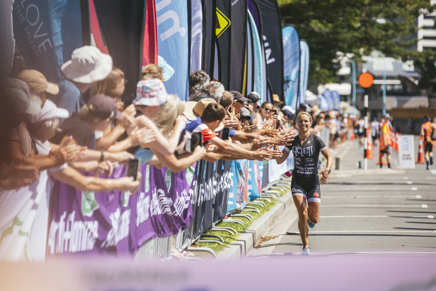 Triathlete Hannah Wells on her way to winning the 2019 Tauranga Half Ironman/Middle Distance National Championships.  Photo credit: Jemma Wells Photography