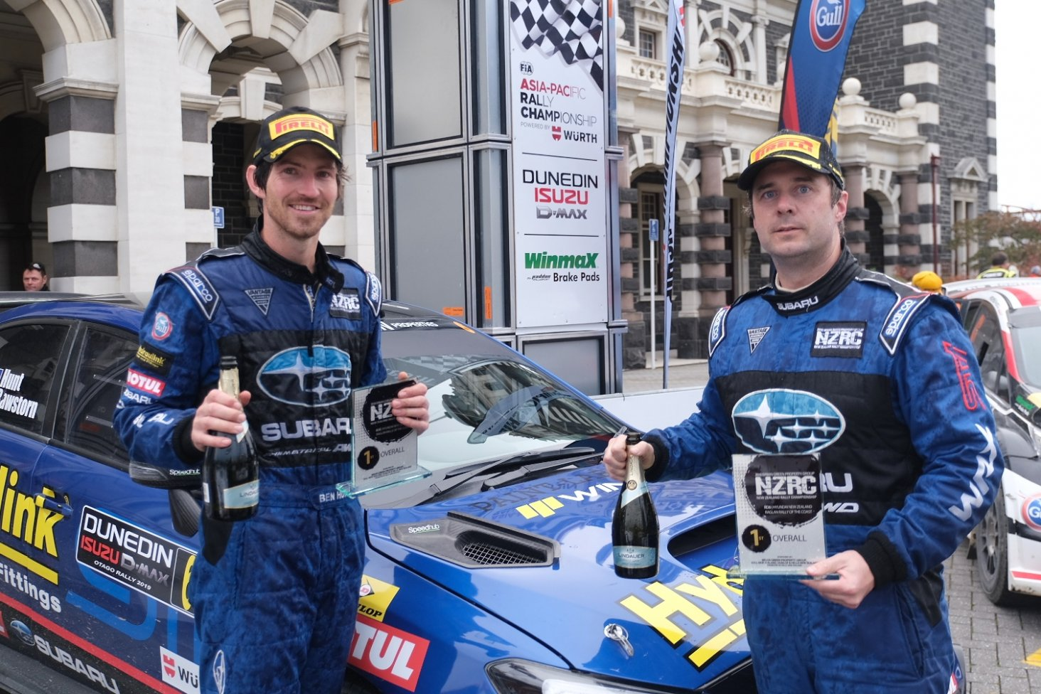Subaru driver Ben Hunt (left) and co-driver Tony Rawstorn celebrate winning the NZRC section of the Drivesouth Rally of Otago . Photo: Geoff Ridder.