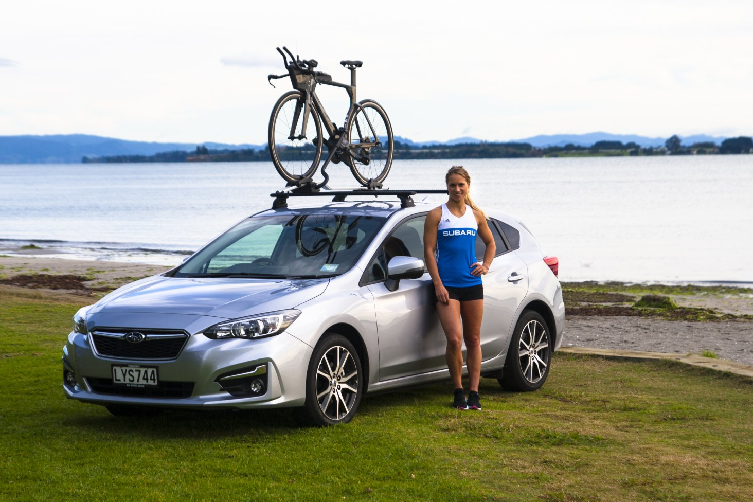 New Subaru brand amabassador Hannah Wells with her Subaru Impreza. Photo Credit: Paul Brunskill
