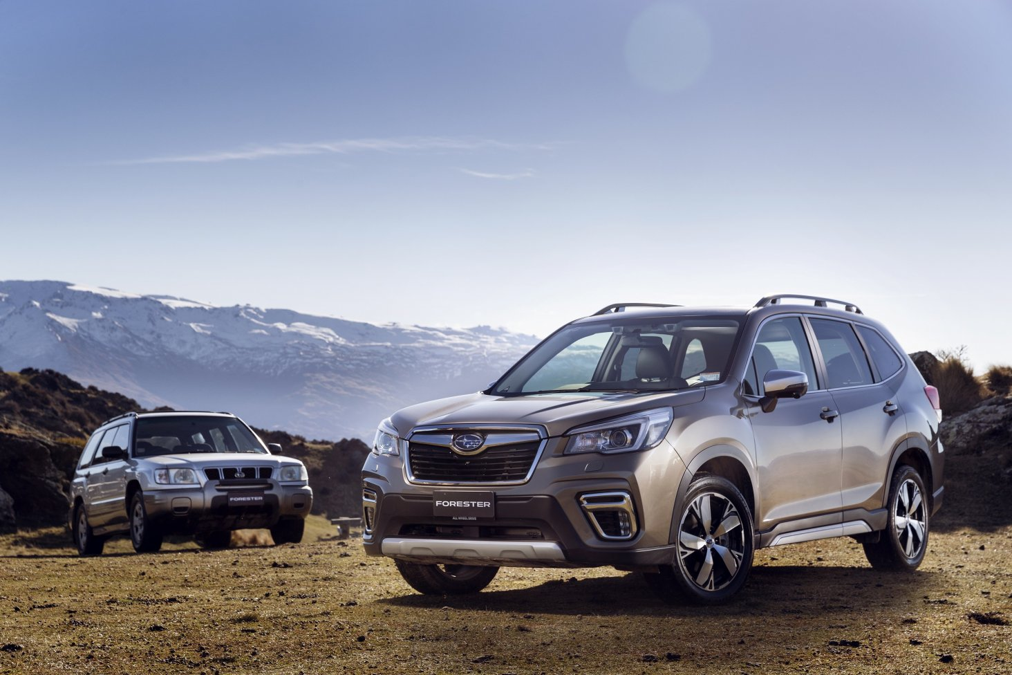 The first Subaru Forester model was launched in New Zealand in 1997 (left) and 21 years later the fifth generation Forester is upgrading families' fun.