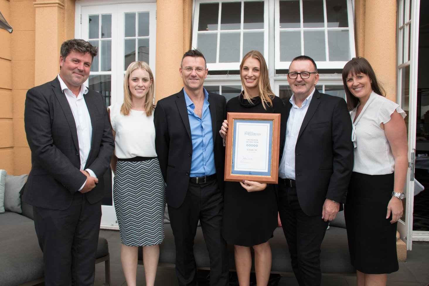 At the awards function are (from left) the NBR's Motoring Editor Cameron Officer and the Subaru team of Amie Mellor, Wayne McClennan, Ally French, Wallis Dumper and Daile Stephens.