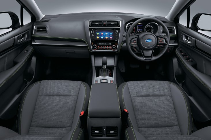 The Outback X's interior includes green stitching on the seats, centre console, steering wheel and gear shift boot.