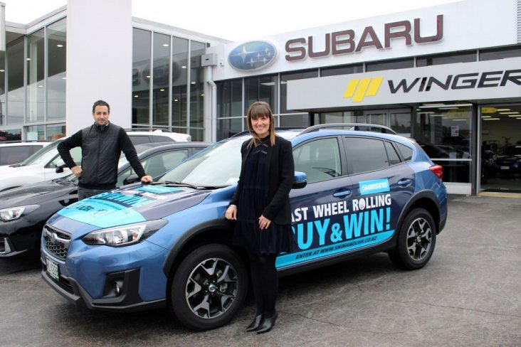 Shimano NZ GM Ben Ashby and Subaru NZ National Marketing Manager Daile Stephens stand with the promo Subaru XV Sport which toured Shimano stockists nationwide as part of the Last Wheel Rolling promotion.