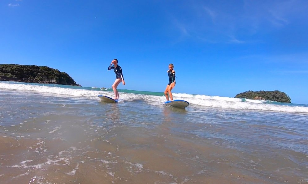 Grace and Sophie catching waves and learning to surf PC: Surf2Surf