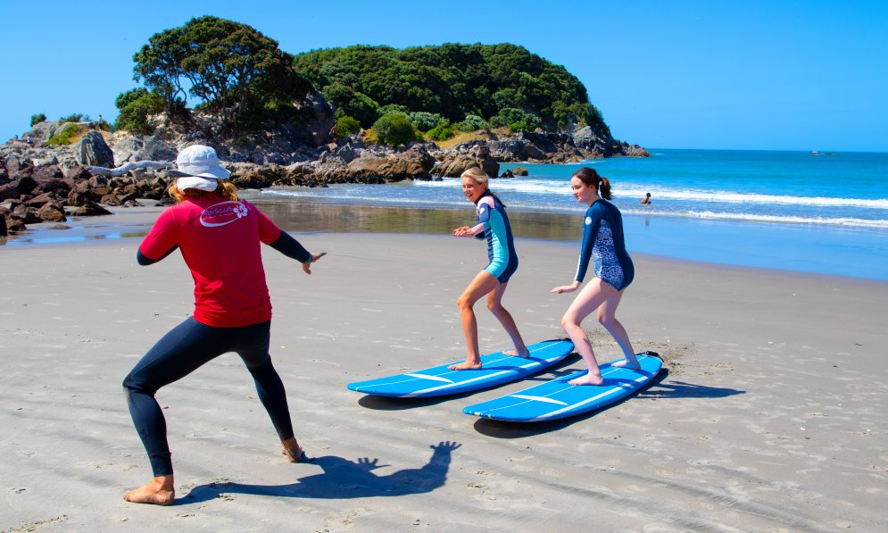 Surf school helps kids learn how to surf on shore first. PC: Surf2Surf