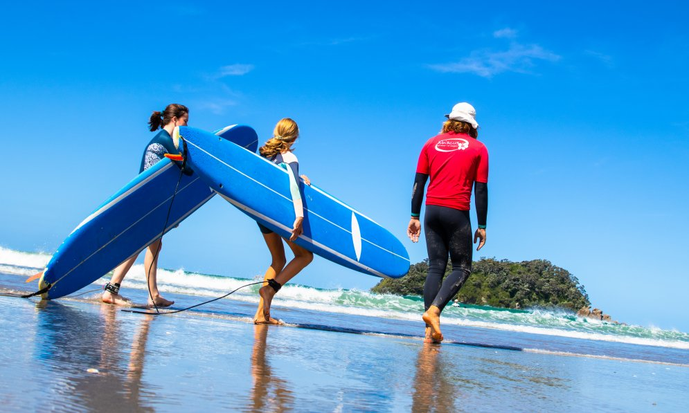 Kids can learn to surf with a professional instructor to help guide them. PC: Surf2Surf